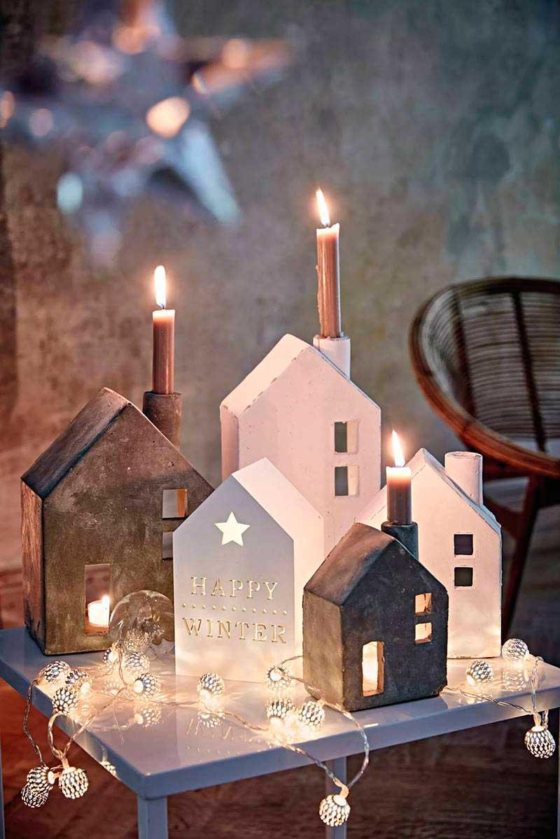 centro de mesa con casas de luz